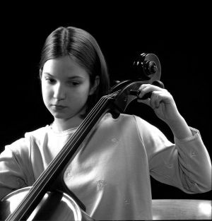 Young cellist tuning